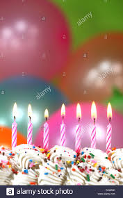 happy birthday celebration with balloons candles and cake stock