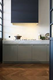 modern kitchen vent hood with cool design feat marble countertop