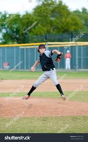 young teen boy on pitching mound stock photo 505051720 shutterstock