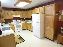 How To Paint Oak Kitchen Cabinets White by Painting Oak Cabinets Thriving Home
