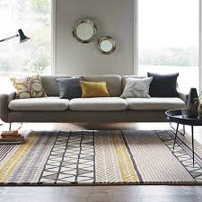 Gray Green Rug Scion Raita Rugs In Taupe Feature A Clever Mix Of Graphic Designs