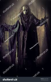 faceless mask halloween scary man iron mask black robe stock photo 299317055 shutterstock