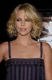 medium length haircuts curly hair highlight medium length hairstyles with bangs for curly hair