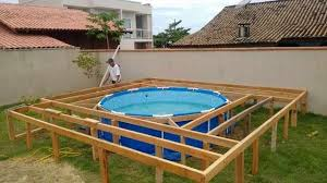 budget friendly above ground pool with absolutely amazing diy deck