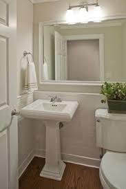 cottage full bathroom with wainscotting kohler memoirs classic
