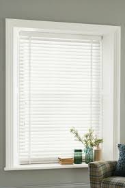 decor white faux wood blinds with decorative plant on pot with