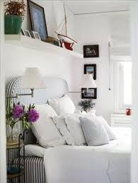 Shelves Over Bed Inspiration In White Natural Home Khakis Bedspread And Cozy