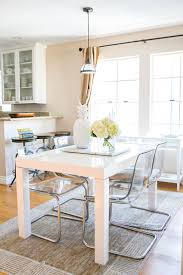 best 25 lucite chairs ideas on pinterest clear chairs ghost light and airy white dining table louise roe s los angeles townhome tour theeverygirl