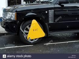 land rover london black range rover clamped in london royal borough of kensington