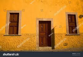 bright yellow adobe house brown doors stock photo 10105045