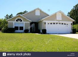 suburban florida house with a two car garage stock photo royalty