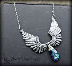metal necklace designs images Angel wings and crystal blue swarovski crystal pendant wire png