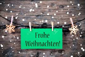 a green label with the german words frohe weihnachten which stock