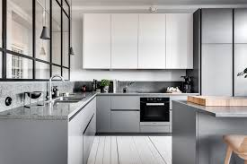 kitchen style white flat cabinets white marble countertop