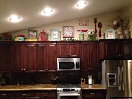 Ideas For Decorating On Top Of Kitchen Cabinets by Way Too Much Going On For My Taste But I Can Use My Decal Above