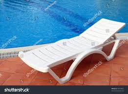 lounge sunbed swimming pool invite you stock photo 39374863