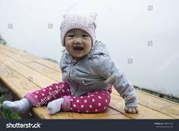portrait happy asian baby child wearing stock photo 548851972