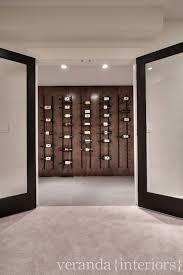 glass and iron wine cellar doors design ideas