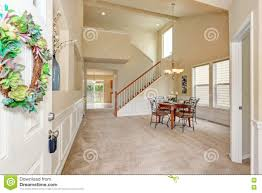 opened front door to high ceiling beige dining room interior royalty free stock photo download opened front door to high ceiling beige dining room