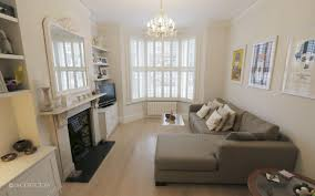 victorian terrace sitting room corner sofa plantation shutters