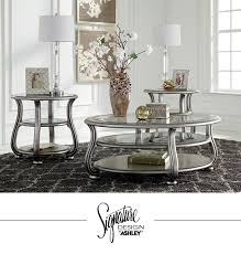ashley furniture round coffee table coralayne tables living room furniture and accessories ashley