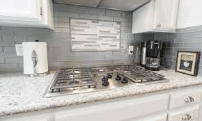 Stacked Stone Kitchen Backsplash Flooring Traditional Kitchen Design With Granite Countertop And