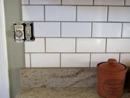 tiles backsplash brown granite countertops with cabinets