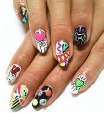orange rounded nails with a feather nail art get polished nail