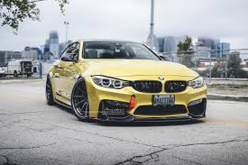 stanced bmw m4 bmw m4 in austin yellow looks amazing with brixton r10d forged