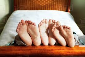 Bed Frame Foot Boys On Bed Frame Stock Photo Dissolve