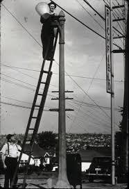 seattle city light change of address file seattle city light worker changing streetlight circa 1930s jpg