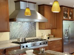 a modern kitchen developing a modern kitchen area with a stainless steel backsplash