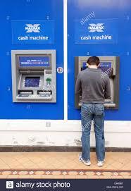 man and cash machine stock photos u0026 man and cash machine stock