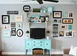 bright living room wall gallery with turquoise cabinet open