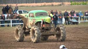 muddy truck king sling monster mud truck rolls huge air dennis