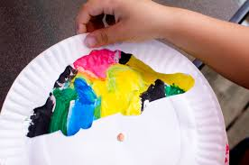 fun dino spinning paper plate craft in honor of dino dana on
