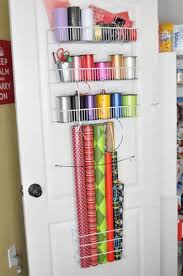 christmas wrapping paper holder 25 simple ways to tackle the messiest chore of the holidays one