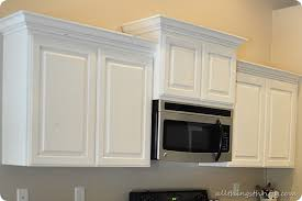 How To Paint Oak Kitchen Cabinets White by How To Paint Your Kitchen Cabinets Professionally All Things