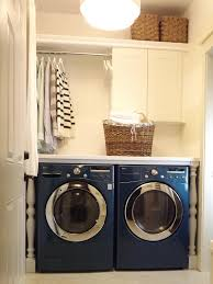 White Laundry Room Cabinets by Floating White Wooden Cabinet With Shelves And Pole For Hanging