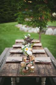 Table Co Transform A Rustic Farm Style Table With Wildflower Bouquets And
