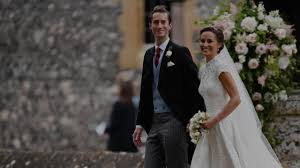 pippa middleton looks very loved up as she attends society wedding