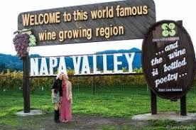 napa valley picture with the sign a must travel