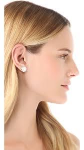large stud earrings burch large t logo stud earrings silver in metallic lyst