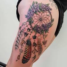 dreamcatcher sleeve tattoos rose flowers and dreamcatcher tattoo on right thigh