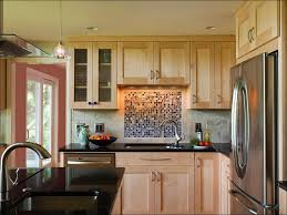 backsplash tile glass and metal brown cabinets glass metal and