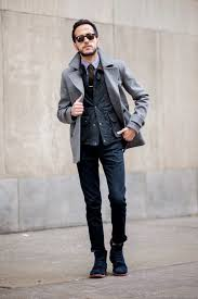 mens dress boots with jeans mixed with black vest and grey blazer also brown tie and black dress boots with rope