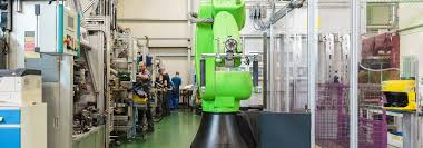first usage of collaborative robots in the automotive industry