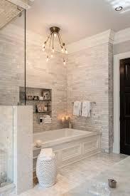 designer master bathrooms master bathroom with herringbone tile on floor freestanding tub