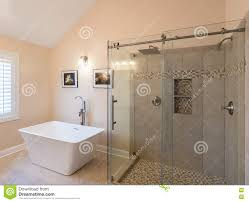 modern bathroom with freestanding tub and shower stock photo royalty free stock photo