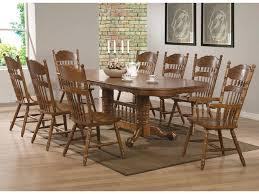 coaster brooks 9 piece table set with oak finish oval trestle